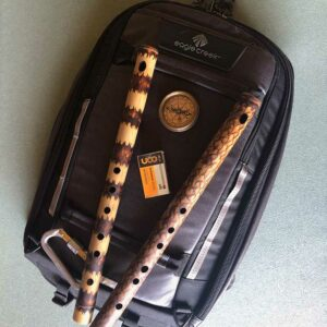 Two bamboo flutes on backpack with camping gear