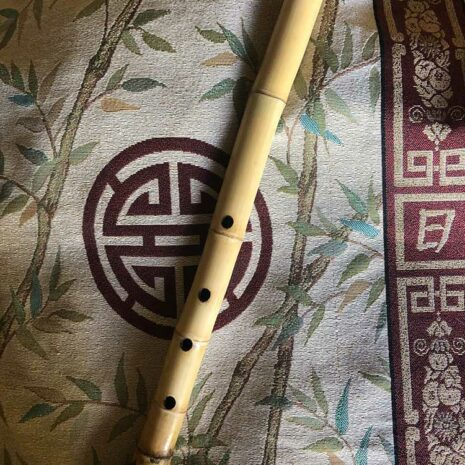 Root section shakuhachi on oriental banner